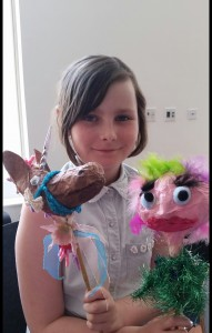 Hazel with puppets