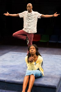 Fiston Barek as Dembe as Faith Omole as Wummie in The Rolling Stone by Chris Urch (Royal Exchange Theatre)