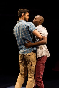 Robert Gilbert as Sam and Fiston Barek as Dembe in The Rolling Stone by Chris Urch (Royal Exchange Theatre)