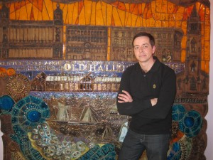 Iain Hoskins in front of the mural which pays homage to Ma Boyle's many years as a provider of oysters for the Liverpool business community