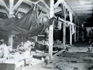 Inside the POW camp barracks, there were 8 people using each bunk at the time