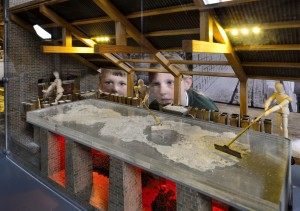 Lion Salt Works - children looking at model of salt pans