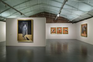 Portrait of Lucian Freud 1951 (left), Three Studies for Figures at the Base of a Crucifixion c.1944 (centre) and Figure Study II 1945–6 (right) by Francis Bacon on display in Francis Bacon: Invisible Rooms at Tate Liverpool until 18 September 2016 © Tate Liverpool, Roger Sinek