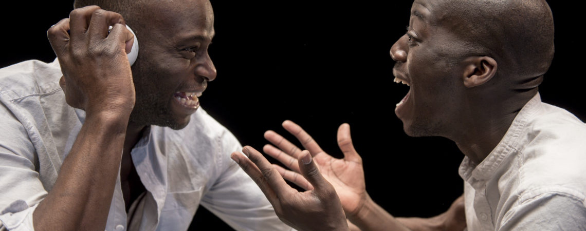 John(Mark Springer) and Winston(Edward Dede) share a joke in The Island which runs at The Dukes from April 28-May 6
