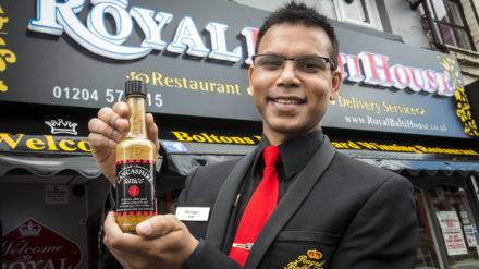 Keith with Lancashire sauce outside The Royal Batli House in Farnworth