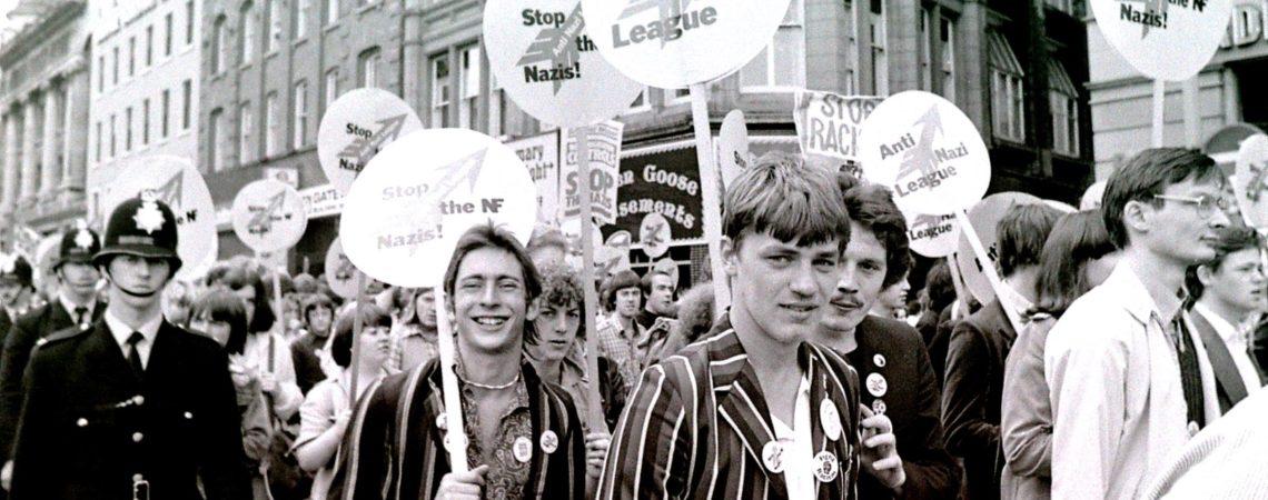Stylish marchers passing through Manchester city centre (c) John Sturrock