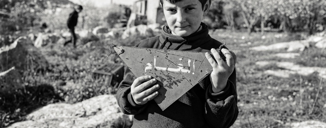 Six year old Hussein accidently wandered into a minefield going to pick wild asparagus. Miraculously he made it out alive by retracing his steps. Credit Sean Sutton.