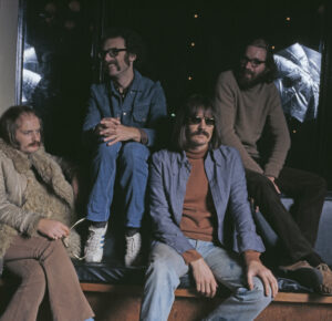 English jazz rock group Soft Machine pictured backstage at a concert in Guildford, England in November 1972. The band are, from left to right: Karl Jenkins, John Marshall, Mike Ratledge and Hugh Hopper. (Photo by Michael Putland/Getty Images)