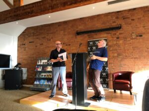 On stage with Pete Ramskill. Henry Normal loves appearing with a series poet