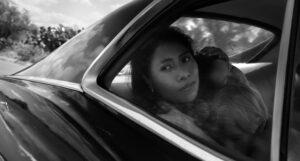 Yalitza Aparicio as Cleo, Marco Graf as Pepe, and Daniela Demesa as Sofi in Roma, written and directed by Alfonso Cuarón.