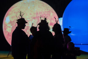 Stags in front of the planet installation, Just So Festival 2021, credit Andrew Allcock