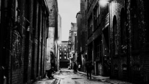 Black and white photograph of a street in Manchester by Paul Williams