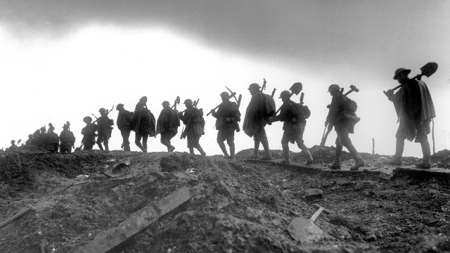 A working party of the Manchester Regiment moving up to the trenches near Serre in France, January 1917