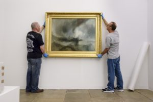 J.M.W. Turner's Snow Storm - Steam-Boat off a Harbour's Mouth exhibited 1842 being installed at Tate Liverpool © Tate Liverpool, Roger Sinek