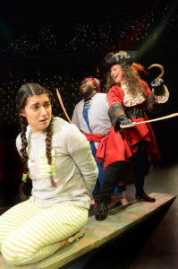 A scene from The Dukes production of Peter Pan featuring Dora Rubinstein as Wendy, Helen Longworth as Captain Hook and Henry Mettle as Smee.