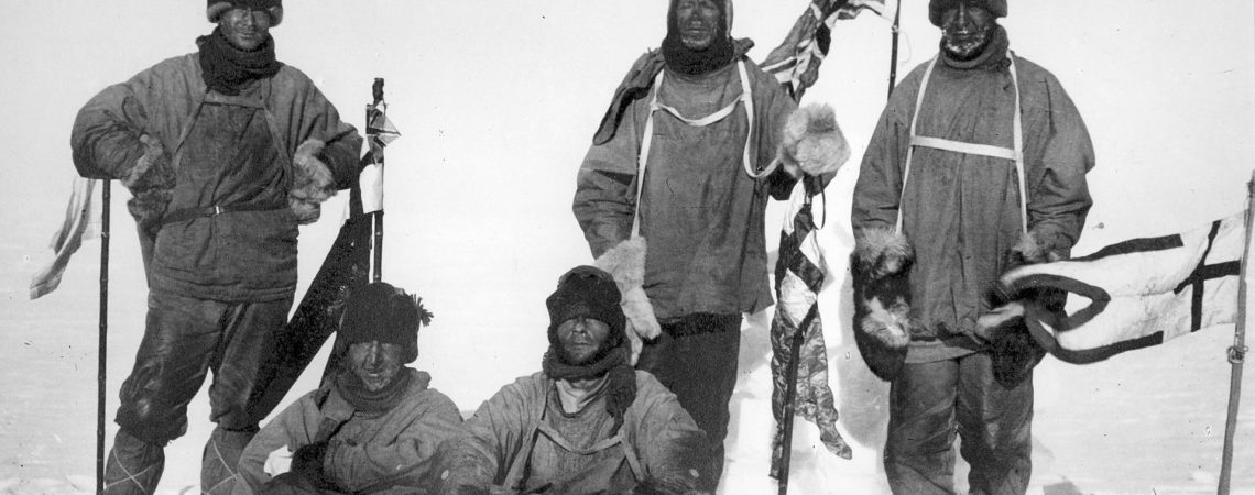 Scott's party at the South Pole, 18 January 1912. L to R: (standing) Wilson, Scott, Oates; (seated) Bowers, Edgar Evans