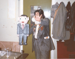 Being Frank The Chris Sievey Story still 2 - Chris Sievey hiding his face, with Little Frank - photo credit Rick Sarko